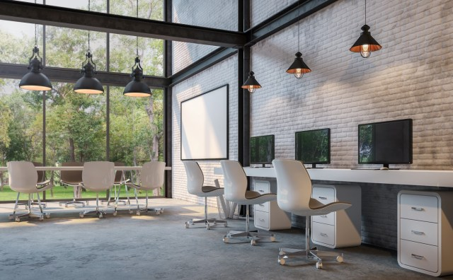 Loft style office 3d rendering image.There are white brick wall,polished concrete floor and black steel structure.Furnished with white furniture.There are large windows look out to see the nature
