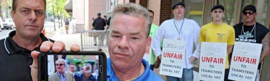 Shawn Dougherty, secretary-treasurer and business agent for Teamsters Local 107, shows his cellphone video of John Dougherty (no relation), of IBEW Local 98, crossing a Teamsters picket line. Photo credit: Clem Murray, Philly Inquirer
