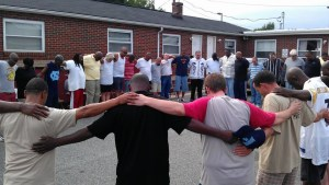 Exodus Homes Residents Praying the Lord's Prayer Together