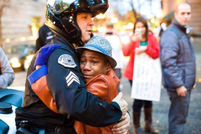 aptopix-ferguson-protest-embrace