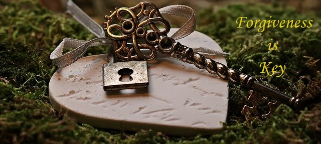 "Lock and key on top of a heart, with a quote ""forgiveness is key""."