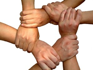 Linking hands teamwork to deliver franchise business success.