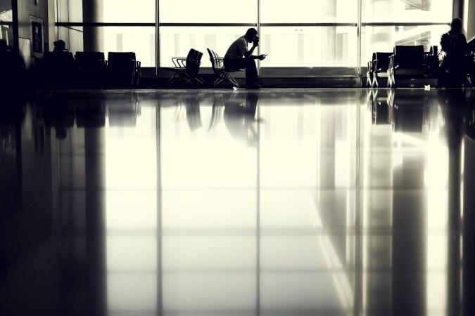 A man waiting in a hospital lobby.
