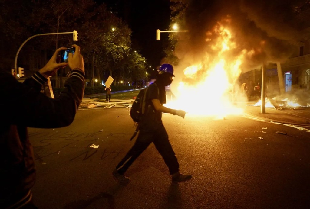 burning barricade at a protest in barcelona