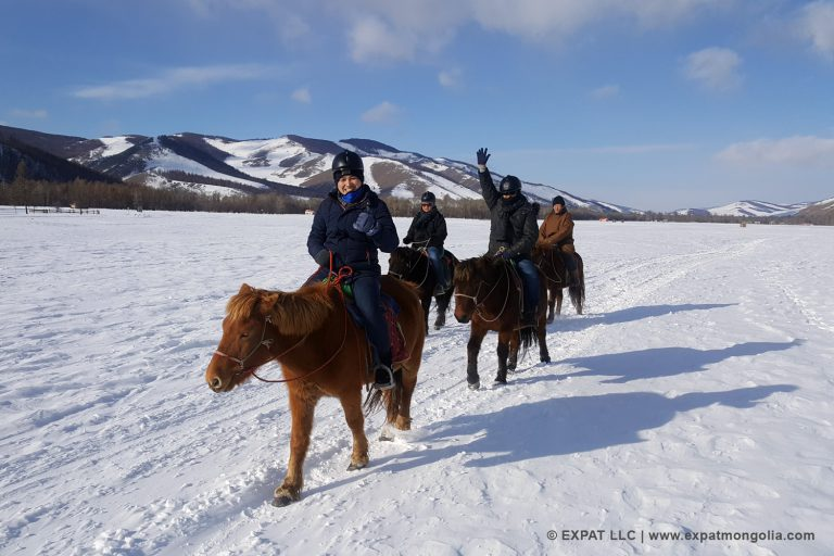 horse riders in snow