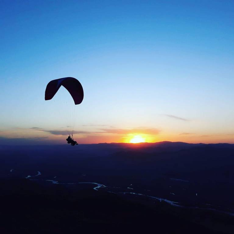 tandem-paragliding-at-sunset