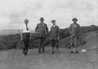 Four gentlemen golfers on the tee of a golf course