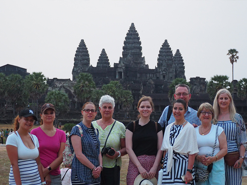 Travellers in front of Ankor Wat in Cambodia