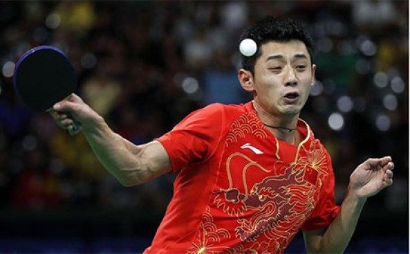 Zhang Jike smashing a lob