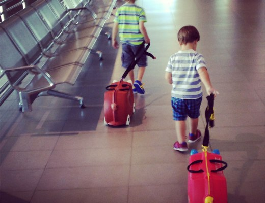 kids pulling a suitcase