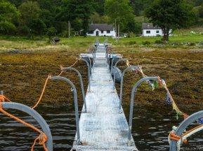 Standing on a jetty on Loch Lomond.