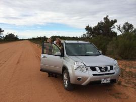 Nikky and I by the car on probably the world's widest road.