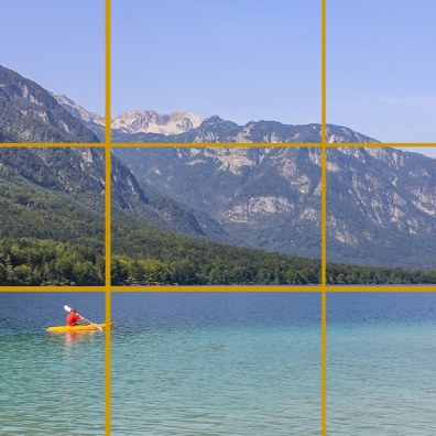 Lake Bohinj, Slovenia. The kayak is near where the bottom and left lines meet. The horizon (here the edge of the lake) follows the bottom line.