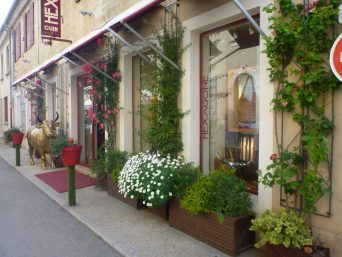 A View of French Street with brand Shop Hexagone Cuir