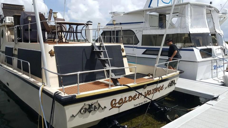 Shows a houseboat at the marina in Tarpon Springs
