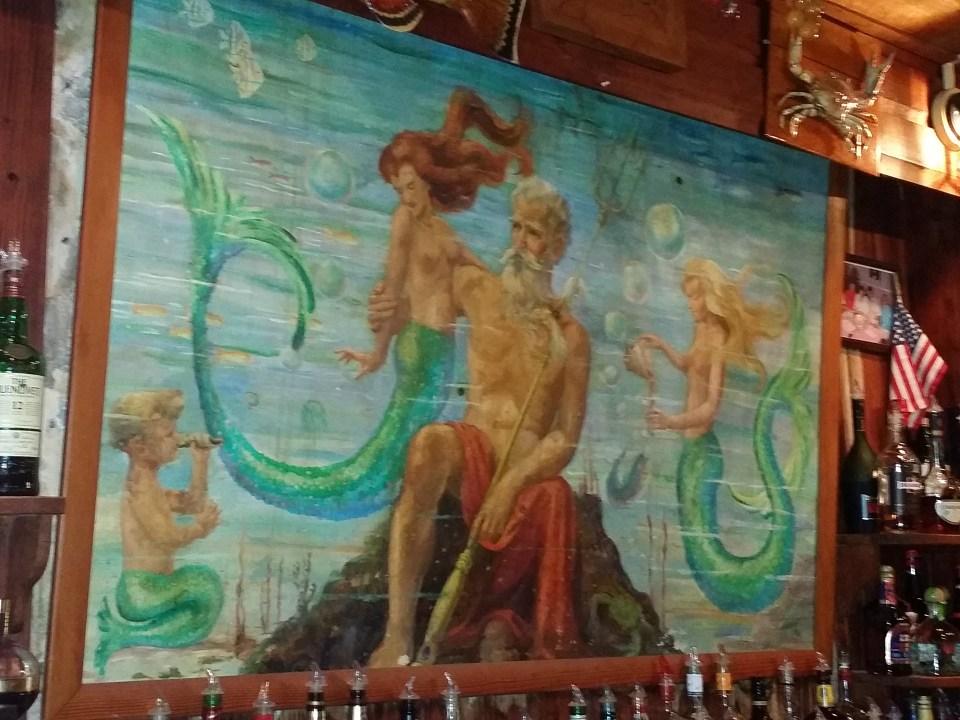 Mural of mermaids and Triton at The Island Hotel, Cedar Key
