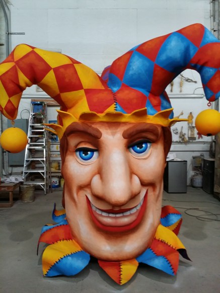 a giant jester head used in a parade float at Mardi Gras World