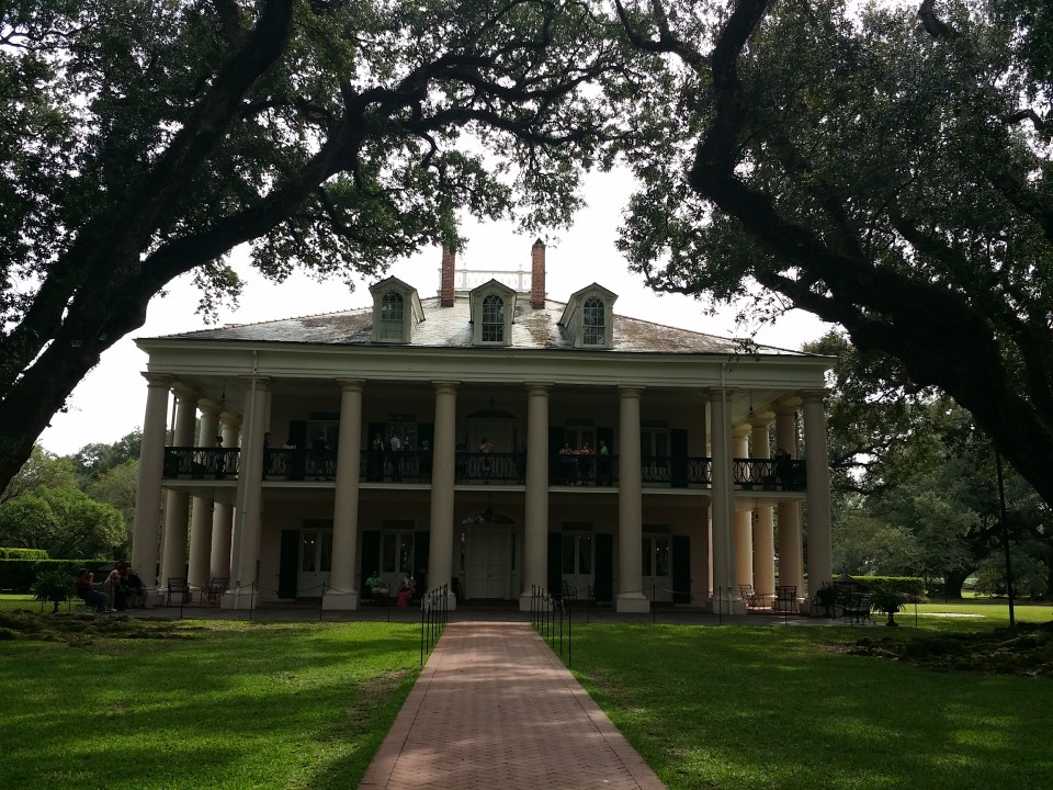 Shows the front view of The Oak Alley Plantation during our road trip down historic River Road to visit several old homes