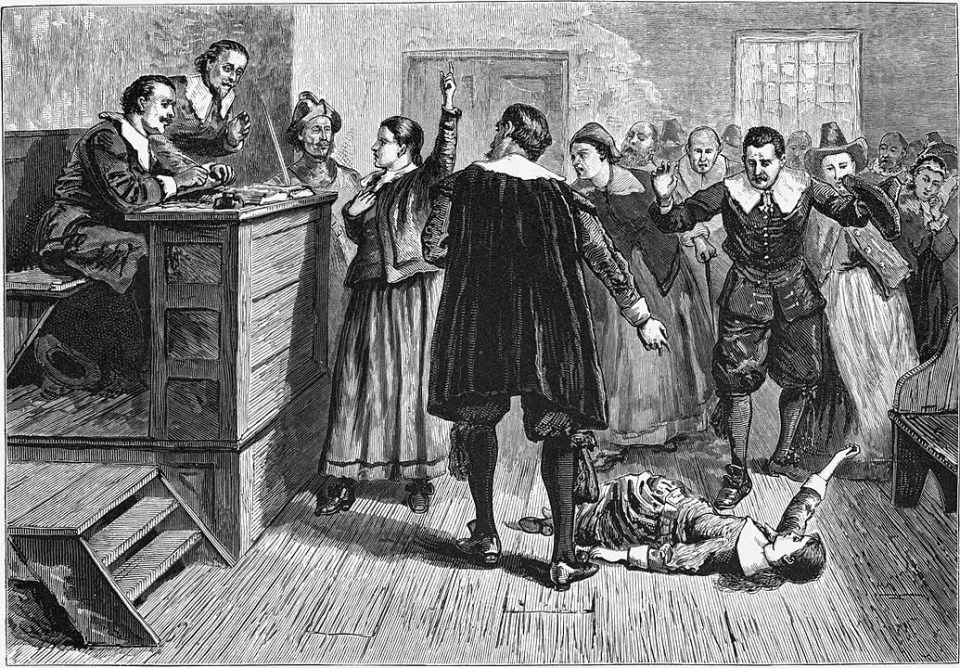 history travel to the time of the Salem witch trials, shows a drawing of people in a court room and a person lying on the floor