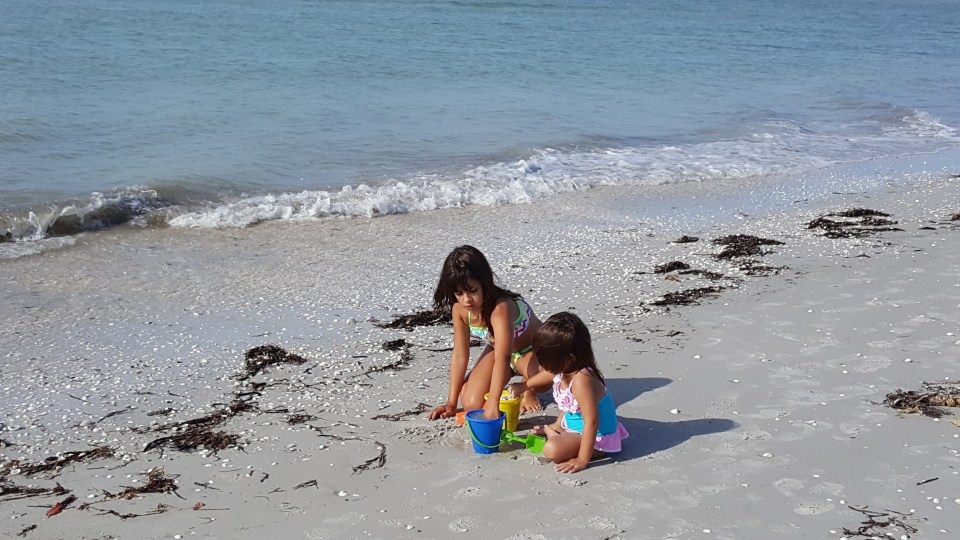 two kids playing in the sand in Sanibel Florida