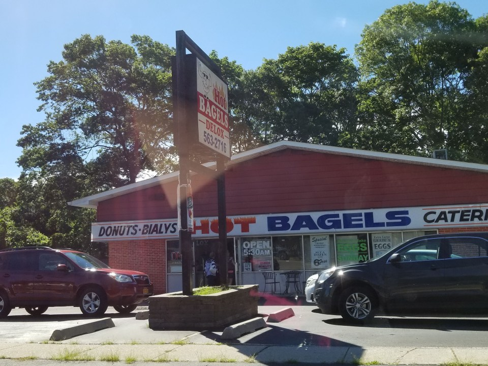 shows the store front for Hot Bagels