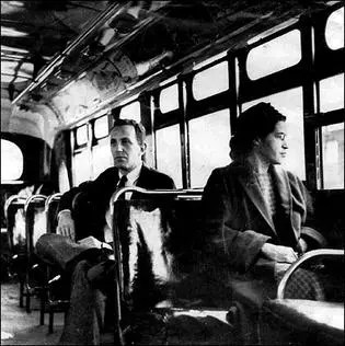 Shows one of the important people in black history, Rosa Parks riding in the front of the bus after the law was changed