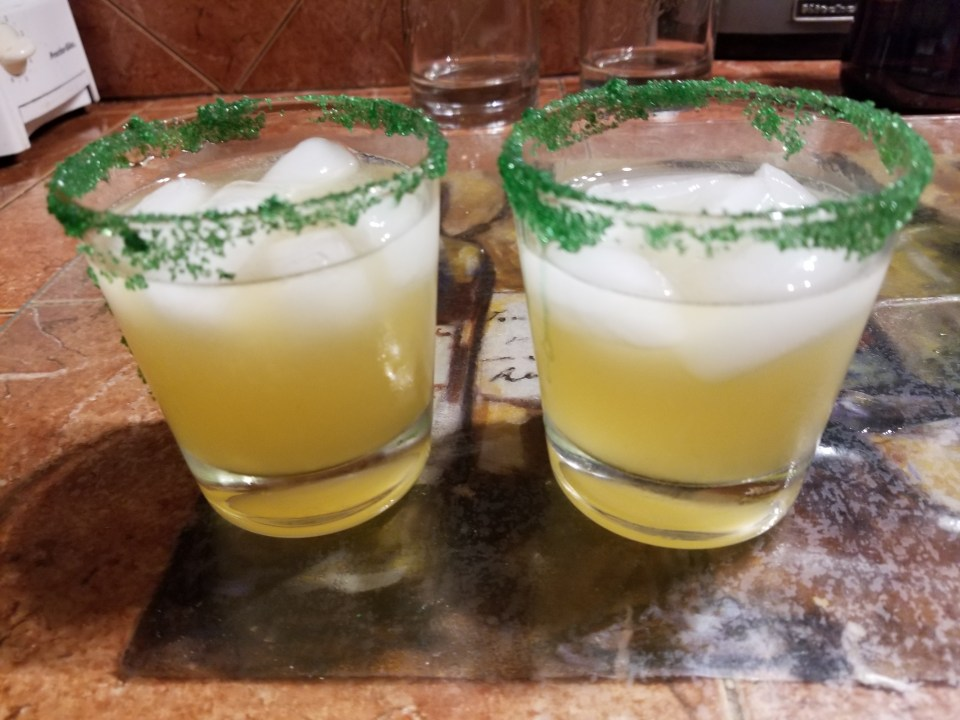 variation of an Irish Whiskey drink, rocks glasses with whiskey sours with green sugar rims
