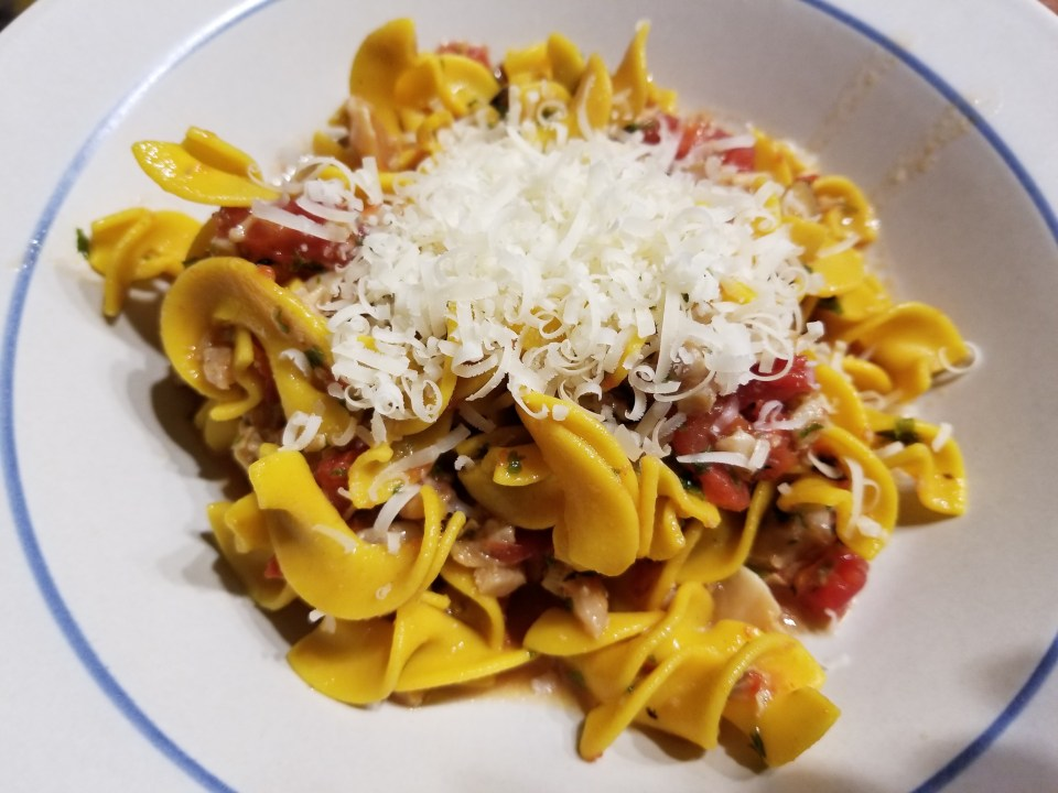 Nonna's menu of Pasta with clam sauce served with grated parmesan cheese
