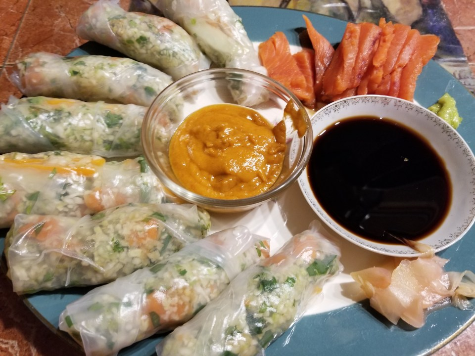 salmon sashimi and salmon spring rolls with peanut sauce and soy sauce great appetizer ideas