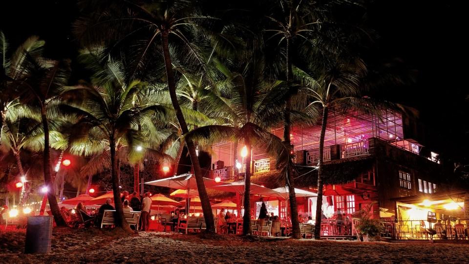 outdoors at night all light up restaurant area at Cabarete's main beach