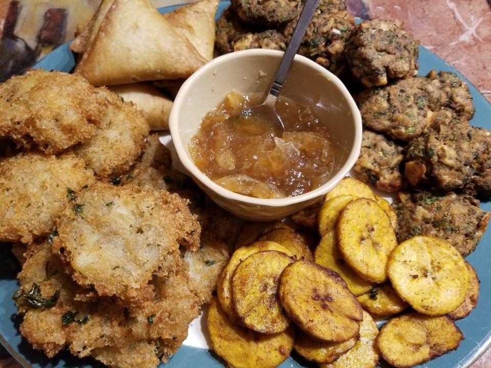 World food from India: vegetable samosas, potato patties, plantain chips, shrimp cakes