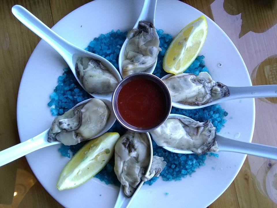 Shows oysters on the half shell at Buoy Beer Company, one of the Astoria restaurants
