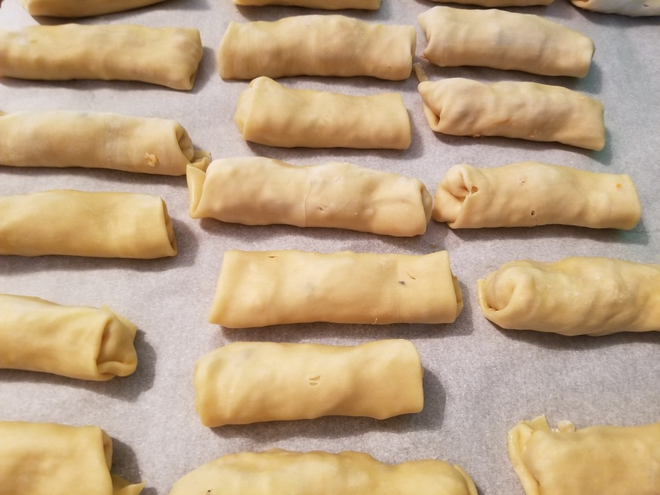 shows how to make egg rolls by drying them slightly prior to cooking