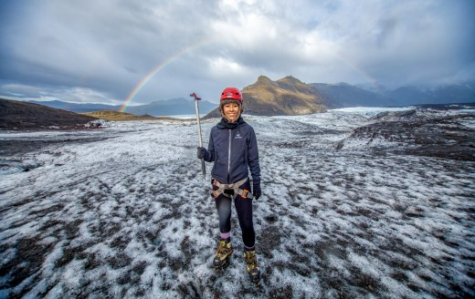 woman walking on glaciers in Iceland