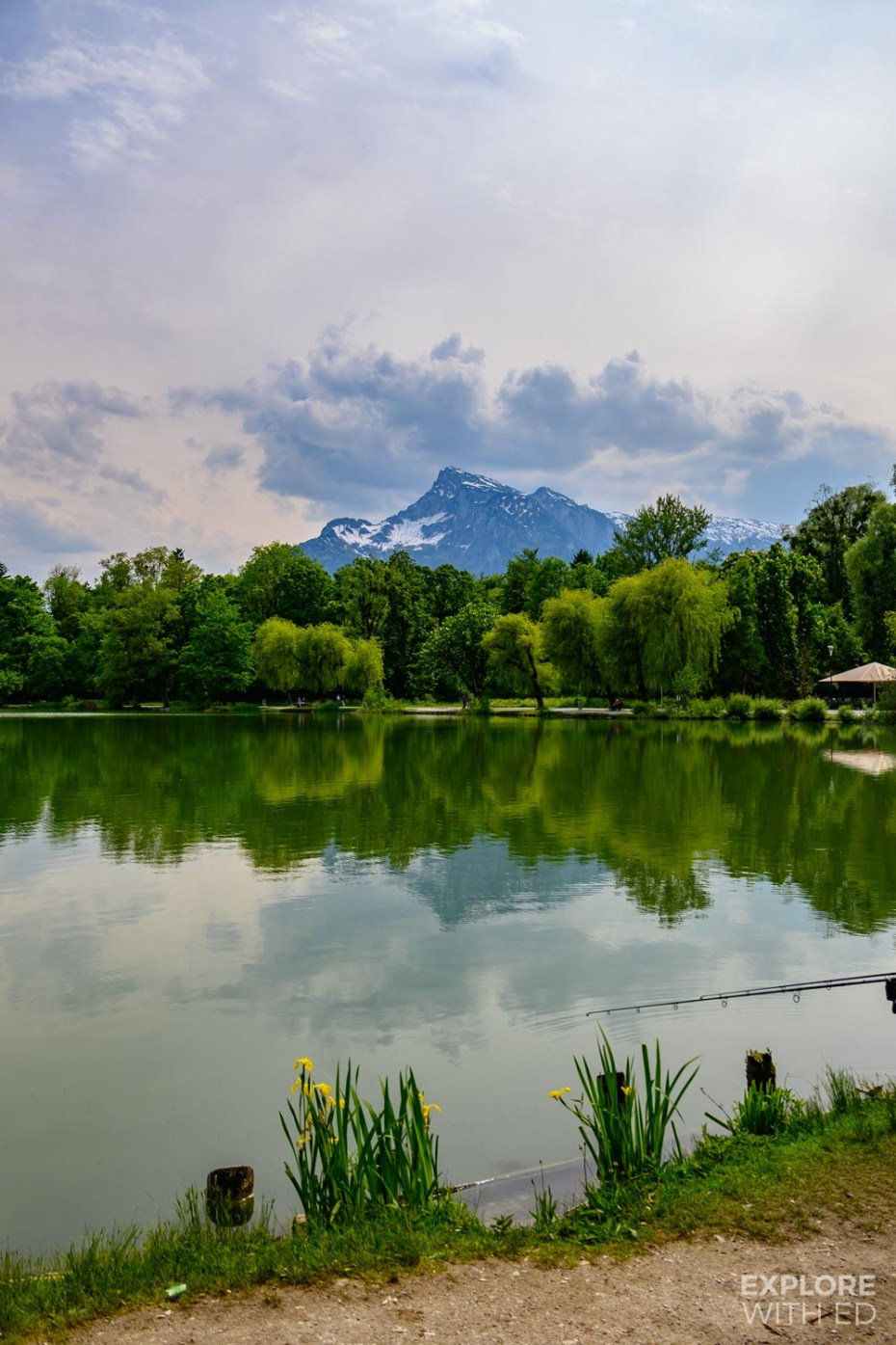 Snow capped mountains and lake at Leopoldskron, Salzburg, Austria