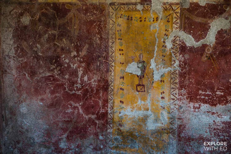 Wall paintings in Pompeii of a soldier