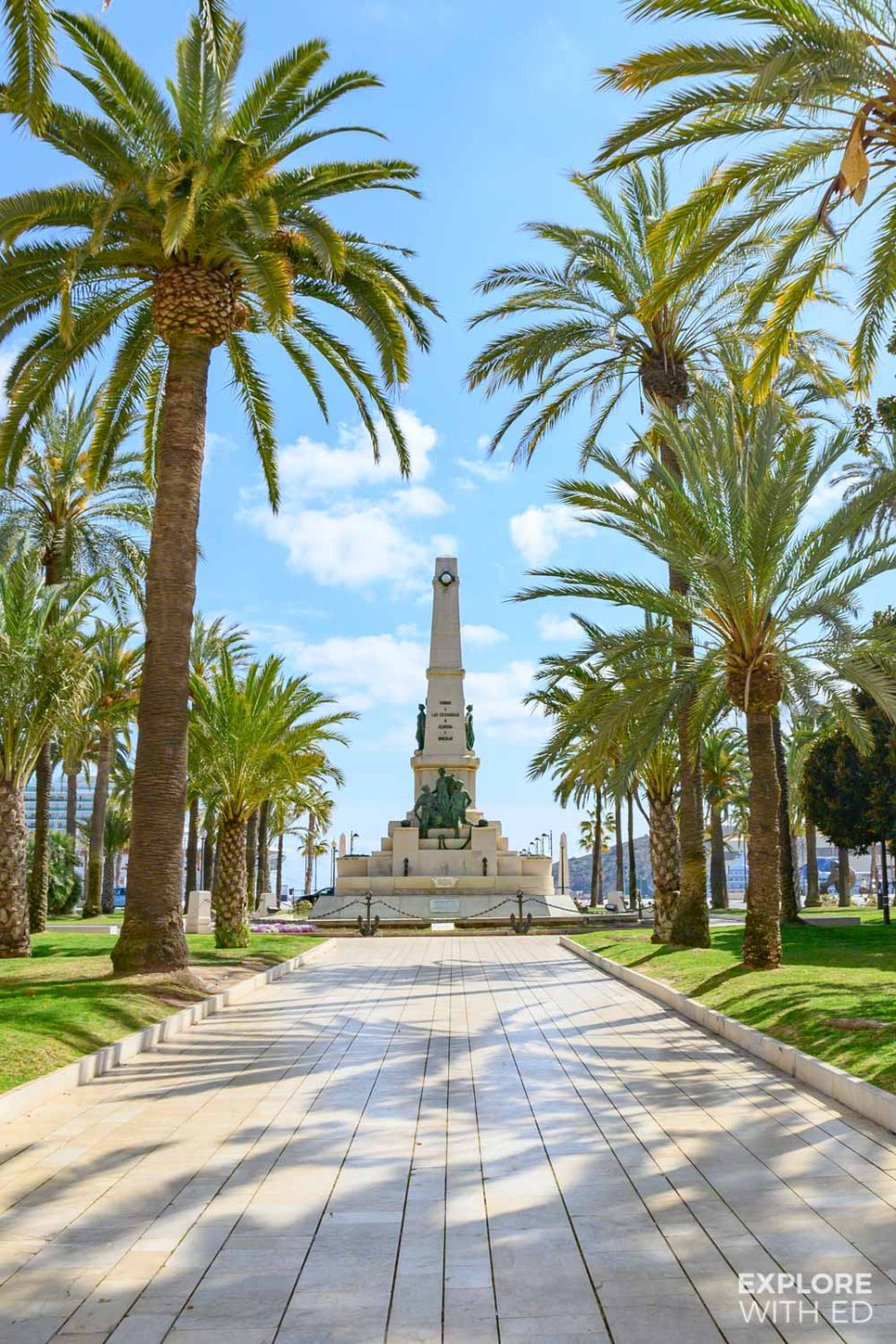 Memorial Monument in Cartagena Spain surrounded by palm trees