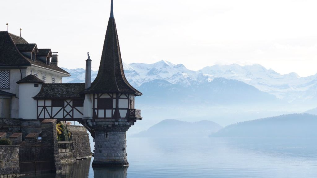 The spectacular Lake Tower of Oberhofen Castle, Switzerland. The Bernese Alps lurk in the background.
