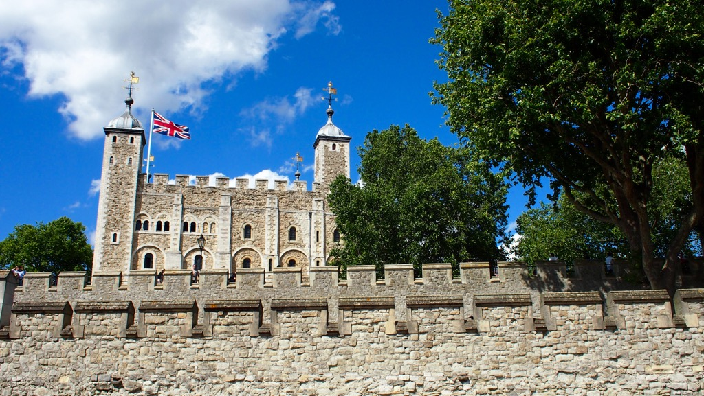 The White Tower pokes out above the curtain wall of the Tower of London.