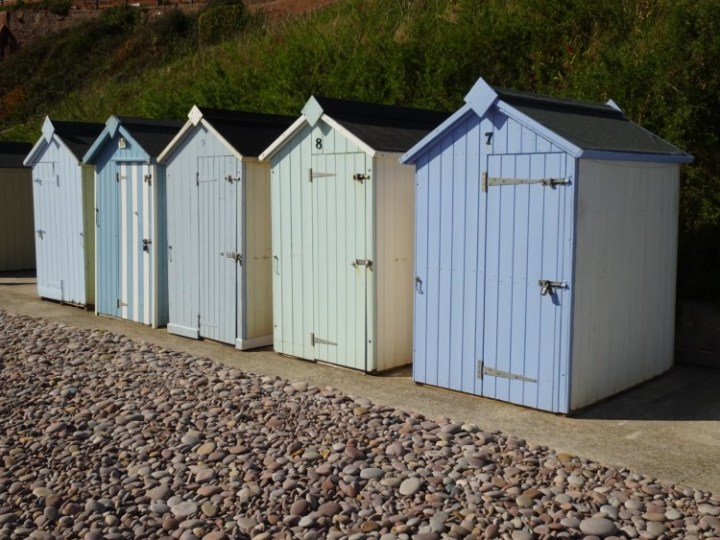 Pastel-coloured beach huts on pink pebbles - this is the 5k hike that has it all