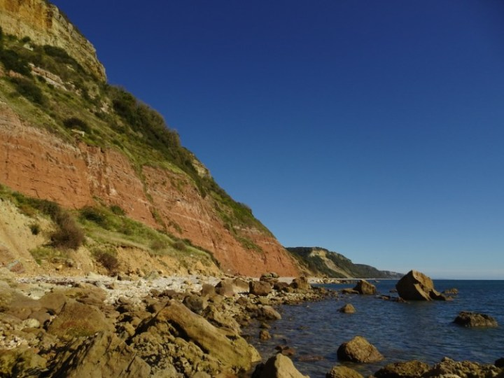 Red and amber cliffs by Salcombe Mouth Beach