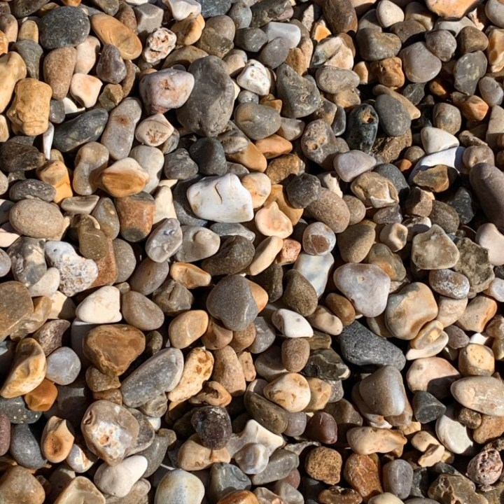 The shingle on Salcombe Mouth Beach looks like it is made of gemstones