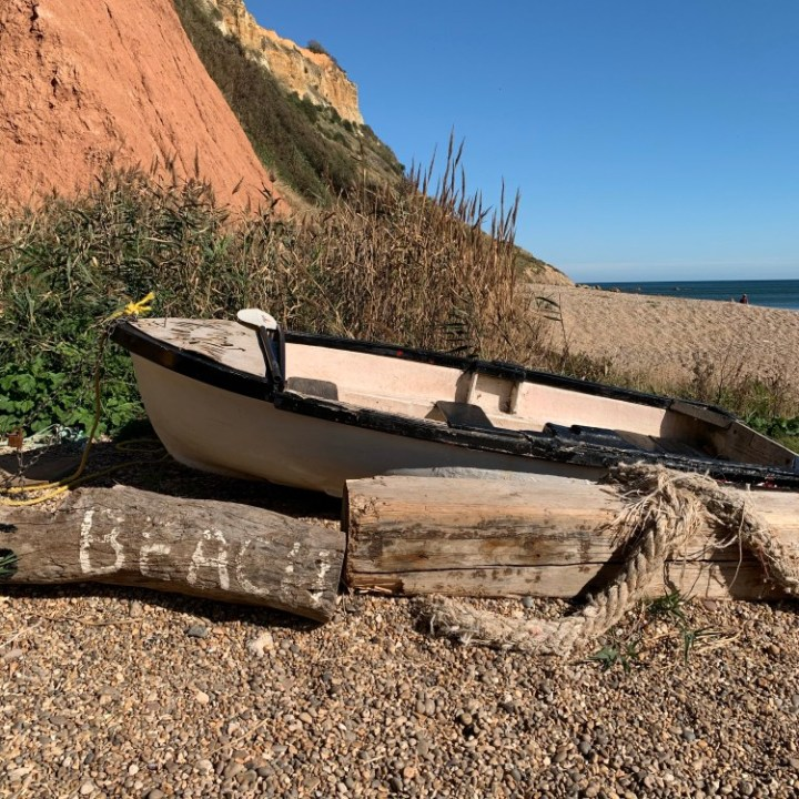 An old rowing boat by the entrance to Salcombe Mouth Beach