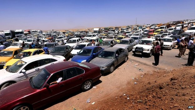 Cars carrying Mosul residents caused a giant traffic jam outside the nearby Kurdish city of Irbil