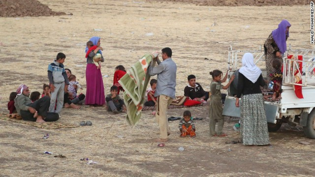 Displaced Iraqis from the Yazidi community settle outside the camp of Bajid Kandala at Feeshkhabour town near the Syria-Iraq border on Saturday, August 9.