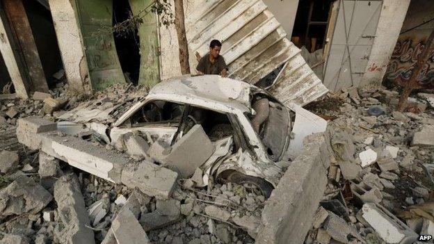 A Palestinian man inspects damage from an Israeli air strike in Jabalia, northern Gaza