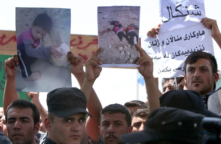 Iraqi Yazidi demonstrate outside the UN offices in the Iraqi city of Arbil, the capital of the autonomous Kurdish region, on August 4, 2014, against the threat imposed by the Islamic State (IS) jihadists against their community in the northern Iraqi town of Sinjar.
