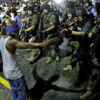 policeman-suspended-for-pointing-a-rifle-at-a-peaceful-protester-in-missouri
