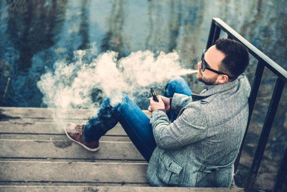 Man exhaling vapor