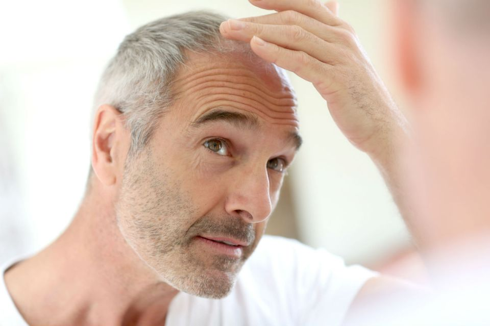 man checking for hair loss